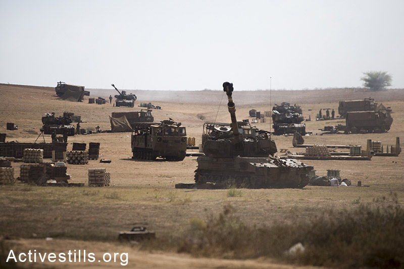 """An Israeli artillery unit fire towards the Gaza Strip from their position on Israel-Gaza border, on July 21, 2014.<span class=""""s1""""> Israeli attacks have killed 550 Palestinians in the current offensive, most of them civilians. (Yotam Ronen/Activestills.org)"""