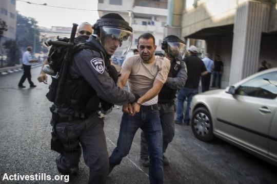 Police arrest an Arab protester during an anti-war demonstration in Nazareth. (photo: Activestills.org)