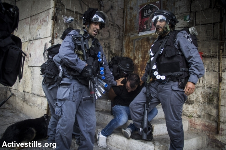 Police arrest an Arab protester during a demonstration in Nazareth against the Gaza war. (photo: Activestills.org)