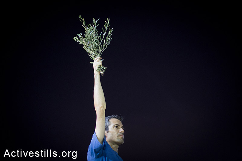 Israeli activists protest in centre Tel Aviv against the Israeli attack on Gaza, calling to end the violence, August 23, 2014. (Activestills.org)