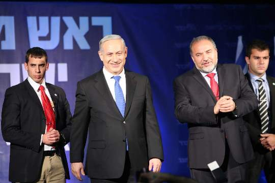 Binyamin Netanyahu and Avigdor Lieberman thank their supporters at the Likud-Yisrael Beitenu headquarters, January 23 2013 (photo: Yotam Ronen / Activestills)