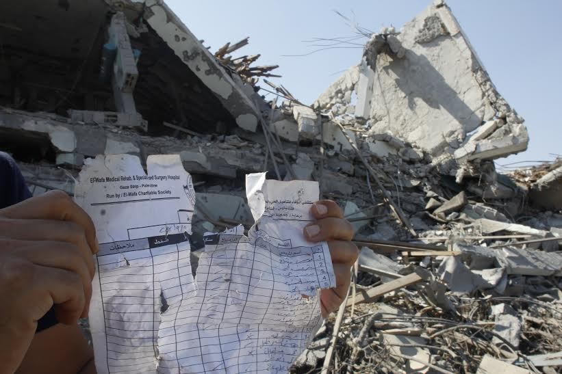 "From this August 6, 2014 photo, reminders of a once active, 50-bed facility in the rubble where El Wafa used to be. The July 23, 2014 airstrike that destroyed El Wafa was included in a list of similar incidents cited as ""possible war crimes"" by Amnesty International. Although Israel's Military Advocate General has since maintained that the hospital served a ""military use,"" Alashi has disputed that claim."