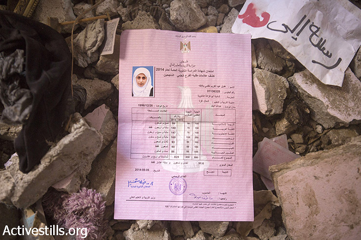 The high school certificate of Adeel,Balata in the ruins of the home of her father Abdelkarim Balata, which was destroyed during an Israeli strike which killed eleven members of the family, Jabalia refugee camp, September 14, 2014. Adeel (17) whose nickname was 'Delo' was killed during the attack. She was a brillant student and wanted to be a doctor. Amid the victims were the almost entire family of Naim Balata who was killed together with his wife and 6 of his children. Only Ala Balata, 18, survived out of the family of Naim who were actually taking refugee in the home of Naim's brother, Abdelkarim. Also killed was the brother of Abdelkarim, Nasme together with his wife (Wafa) and his 1 year and an half son (Abdelkarim). During the seven-week Israeli military offensive, 2,131 Palestinians were killed, including 501 children, and an estimated 18,000 housing units have been either destroyed or severely damaged, leaving more than 108,000 people homeless.