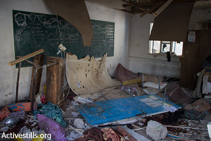 A classroom lies damaged following the overnight Israeli shelling of an UNRWA school where some 3,300 Palestinians were seeking shelter, Jabalia, Gaza Strip, July 30, 2014. At least 20 people were killed in the attack which injured more than 100. So far, Israeli attacks have killed at least 1,300 Palestinians and injured more than 6,900. At the same time, 56 Israeli soldiers have been killed, as well as three civilians in Israel.