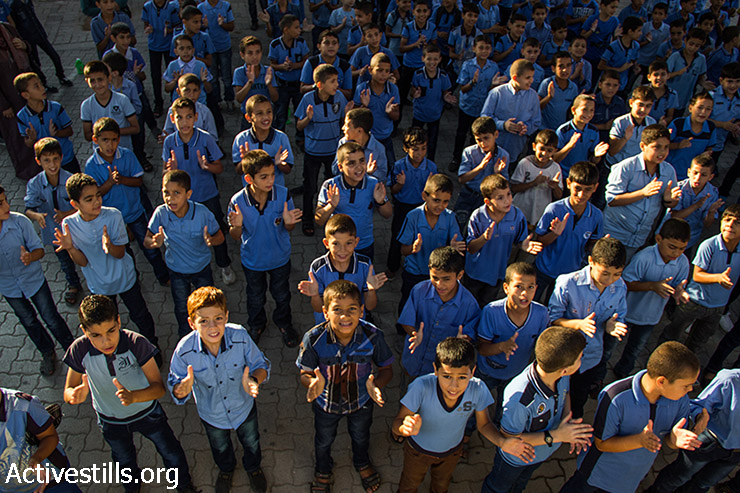 Boys line up in the morning to practice daily exercises at an UNRWA school in Shujaiya neighborhood, Gaza City, September 15, 2014. The first weeks of classes will be dedicated to recreational activities to help children overcome the trauma suffered during the the seven-week Israeli military offensive.