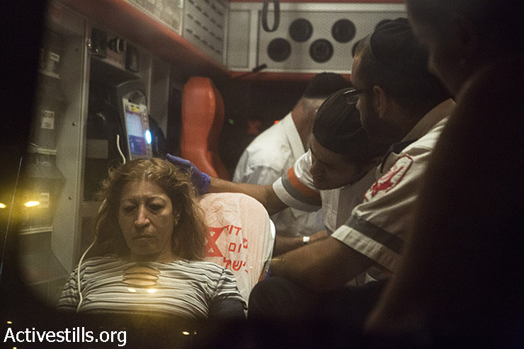 Osnat Hamias is being treated in the ambulance. (Keren Manor/Activestills)