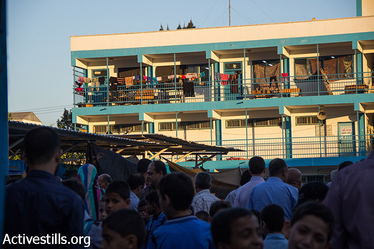 Classrooms in an UNRWA school are stil l inhabited by people whose houses are completely destroyed by Israeli attacks, Shujayea neighborhood, Gaza City, September 15, 2014. The school year has started with a three-week delay, due to the latest Israeli offensive during which 29 schools have been totally destroyed, and around 190 damaged. The first weeks are dedicated to recreational activities to help children to overcome the trauma due the the seven-week Israeli military offensive. 2,131 Palestinians were killed, including 501 children, and an estimated 18,000 housing units have been either destroyed or severely damaged, leaving more than 108,000 people homeless.