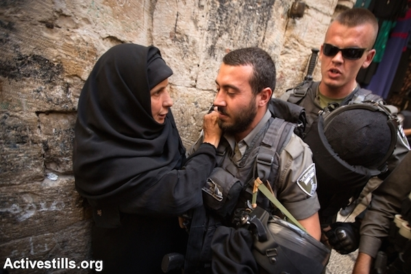 Israeli Border Police officers prevent worshippers from entering the Aqsa Mosque in Jerusalem, September 26, 2014. (Photo by Faiz Abu Rmeleh/Activestills.org)