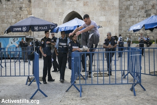 A Palestinian man performs Parkour at an Israeli police checkpoint in the Old City of Jerusalem, September 26, 2014. (Photo by Faiz Abu Rmeleh/Activestills.org)