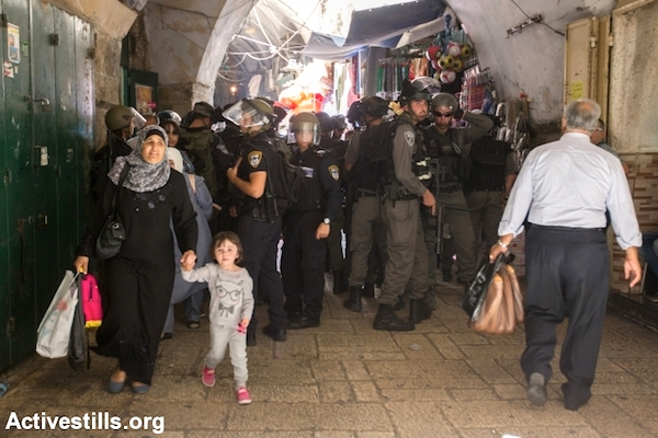 Israeli police officers block an alleyway in the Old City of Jerusalem. (Photo by Faiz Abu Rmeleh/Activestills.org)