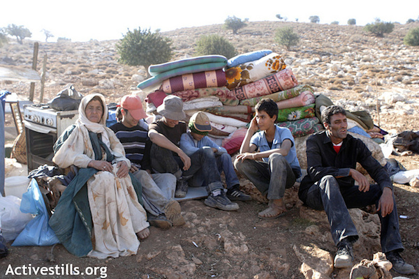 A Palestinian Bedouin family after their Jordan Valley home was demolished by Israeli army forces. (File photo by Anne Paq/Activestills.org)