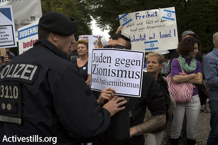 "Anti-Zionist Jews in Berlin, September 14, 2014. The sign reads: ""Jews against Zionism and anti-Semitism"". (Oren Ziv/Activestills.org)"