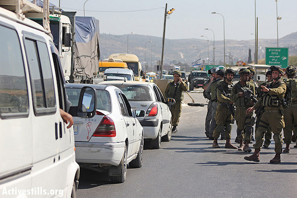 Illustrative photo of Israeli soldiers closing an internal West Bank checkpoint, May 15, 2012. (Photo by Ahmad Al-Bazz/ Acitvestills.org)