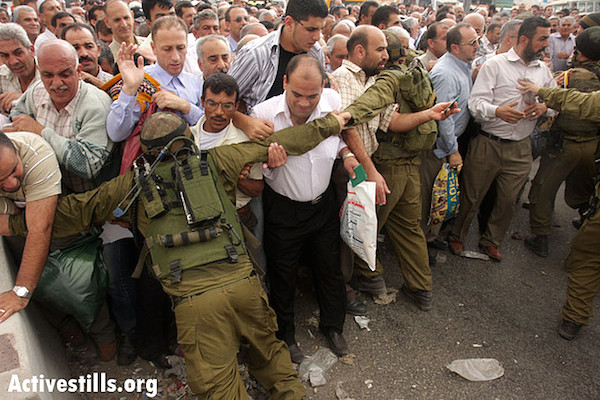 Israeli soldiers attempt to control a crowd of Palestinian men at the Qalandia checkpoint separating Jerusalem and Ramallah, September 27, 2008. (Photo by Anne Paq/Activestills.org)