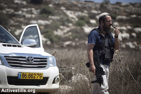 Illustrative photo of an Israeli settlement's civilian security coordinator. (Oren Ziv/Activestills.org)