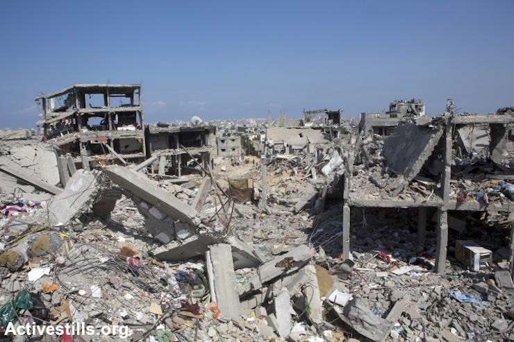 A destroyed quarter in At-Tuffah district of Gaza city, which was heavily attacked during last Israeli offensive, Gaza city, September 5, 2014. (Photo by Anne Paq / Activestills.org)