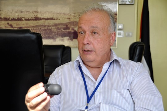 Dr. Rafik Husseini, director of Al-Makassed Hospital in East Jerusalem, holds a new crowd-control projectile the Israeli army is using in the occupied territories. (Photo by Yael Marom)