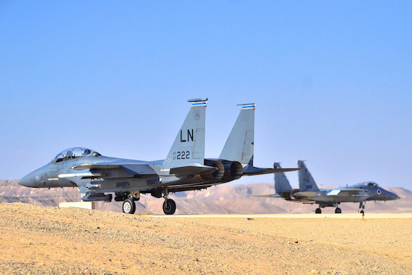 "Israeli and American F-15 airplanes cooperating during the ""Blue Flag"" exercise in November 2013. (Photo by Gui Ashash/IAF)"