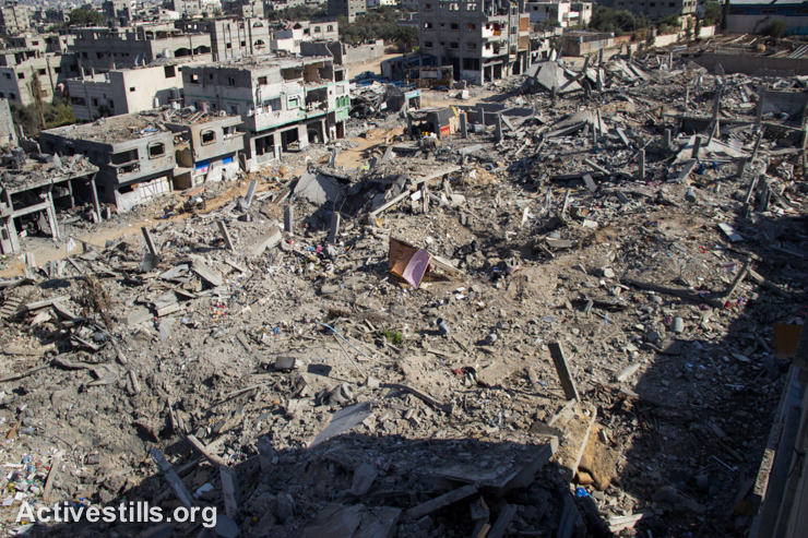 A tent sits among the rubble in a destroyed section of the Shujayea neighborood, which was heavily attacked during the latest Israeli offensive, Gaza City, September 4, 2014. During the seven-week Israeli military offensive, 2,131 Palestinians were killed, including 501 children, and an estimated 18,000 housing units have been either destroyed or severely damaged, leaving more than 108,000 people homeless. (photo: Activestills)