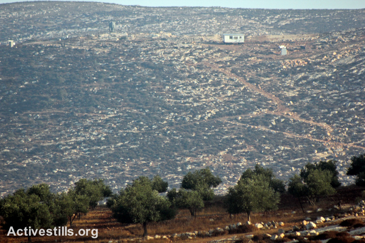 A new Israeli settlement outpost is seen near Palestinian olive groves in Salem village, near Nablus, West Bank, October 9, 2014.
