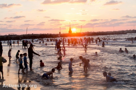Palestinians gather at the beach at sunset in Al Meena, Gaza City, September 12, 2014. After seven weeks of Israeli offensive, during which most Palestinians were confined to their homes, many Palestinians went to the beach to enjoy some open space.