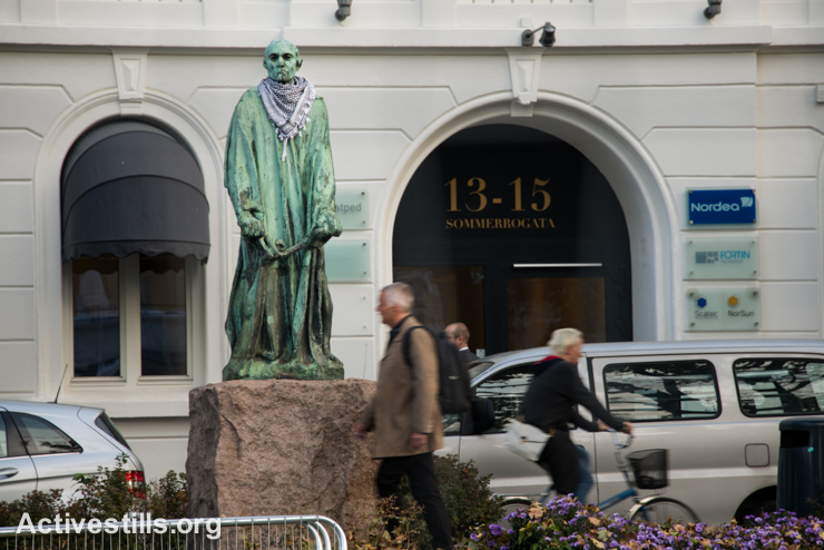 "The statue ""Man with Key"" by sculptor Auguste Rodin stands decorated with a keffiyeh scarf as a symbol of solidarity with Palestine, Oslo, Norway, September 18, 2014."