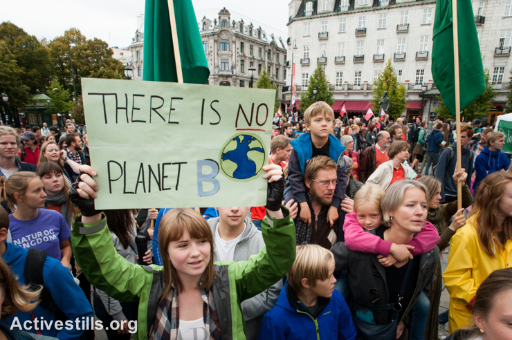 "Thousands march through central Oslo, Norway, to call for action to fight global climate change, September 21, 2014. According to organizers of the worldwide ""People's Climate March"", this demonstration was one of 2,808 protest events in 166 countries, which they claim was ""the largest climate march in history."""