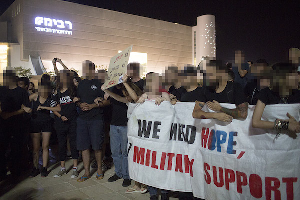 Protecting a protest against the war outside Israel's national theater in Tel Aviv.
