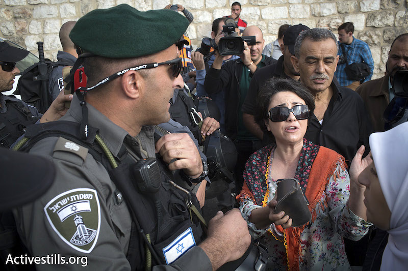 MK Haneen Zoabi tries to enter the Aqsa Mosque via the Lions' Gate, October 15, 2014. Police eventually let her and other members of Knesset enter. (Photo by Oren Ziv/Activestills.org)
