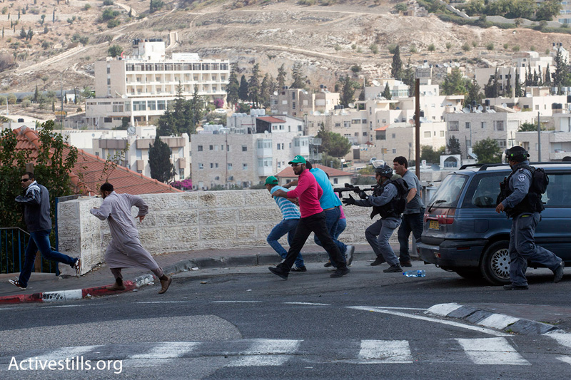 Police push protesters away from the Old City toward the East Jerusalem neighborhood of Wadi Joz, using stun grenades and water canons, October 15, 2014. (Photo by Oren Ziv/Activestills.org)