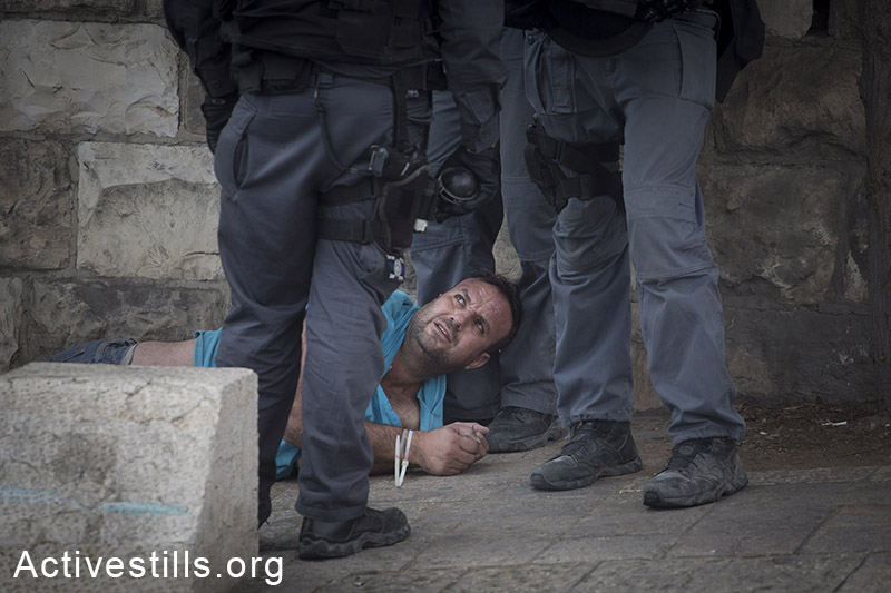 Israeli policemen arrest a Palestinian protester during a protest outside Jerusalem's old city against the Israeli authorities' policy in resent weeks to limit access for Muslim worshippers to the al-Aqsa mosque compound, October 15, 2014. At least four protesters were arrested after Israeli police dispersed the protest. Muslim men and women over 50 are allowed to enter the compound in recent weeks, as Jewish right-wing activists enter al-Aqsa mosque compound with police escort. (Activestills.org)