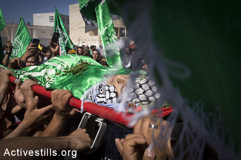 Palestinians carry the body of Orwa Hammad, a 14-year old, at his funeral in the West Bank village of Silwad, October 26, 2014. Israeli soldiers shot and killed Hammad, which was an American citizen, during clashes in his village on October 24, 2014.(Activestills.org)