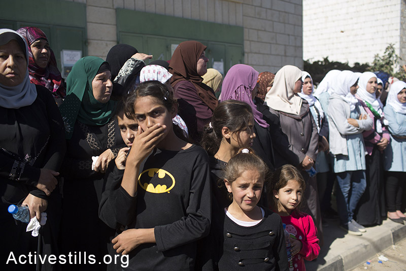 Palestinians girls cry at the funeral of Orwa Hammad, a 14-year old, in the West Bank village of Silwad, October 26, 2014. Israeli soldiers shot and killed Hammad, which was an American citizen, during clashes in his village on October 24, 2014. (Activestills.org)
