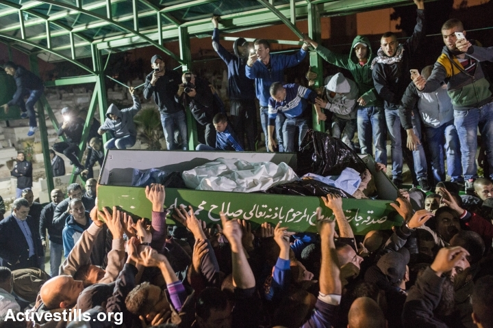 Palestinians attend the night funeral of Moataz Hejazi, outside Jerusalem's old city, October 30, 2014. Police limited the access to funeral to 45 family members, but hundreds of Palestinians managed to enter the premises. Moatez was killed in a raid of the Israeli police on his house in the East Jerusalem neighbourhood of Abu Tor, as he was a suspect in shooting of Israeli right-wing activist Rabbi Yehuda Glick the day before. (photo: Yotam Ronen/Activestills.org)