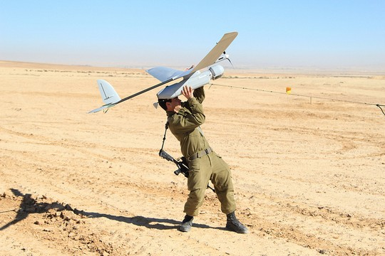 An Israeli soldier holds a drone. Israeli corporations have benefited as the government has poured money into developing security and defense systems. (IDF CC BY-NC 2.0)