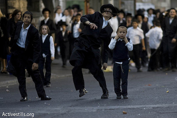 Illustrative photo of ultra-Orthodox Jews throwing stones. (Photo by Activestills.org)