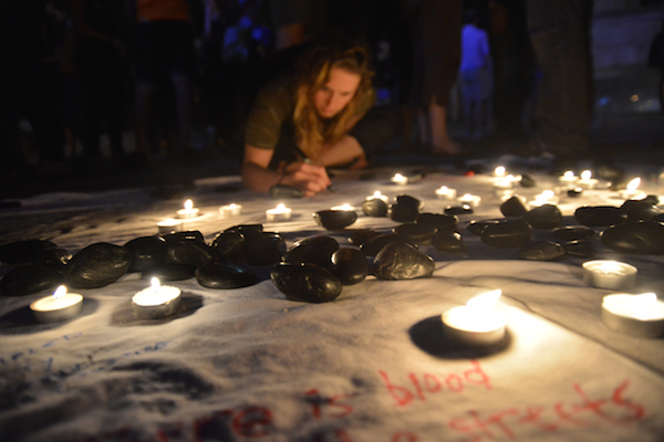 An action by If Not Now, When, for Tisha B'Av in New York City, where participants read the names of Israelis and Palestinians who died in this summer's Gaza war. (Photo by Gili Getz)