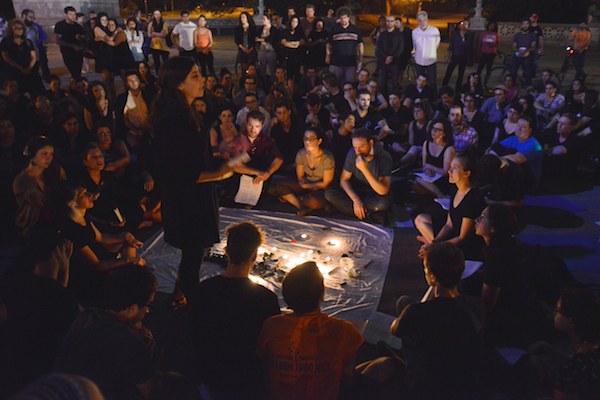 Simone Zimmerman speaks to some 250 IfNotNow activists at a Tisha B'Av action in New York City, where participants read the names of Israelis and Palestinians who died in the 2014 Gaza war. (Photo by Gili Getz)