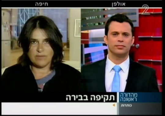 Photographer Dorit Jordan-Dotan being interviewed on Channel 2 News about the incident she documented, February 26, 2013. (Screenshot)