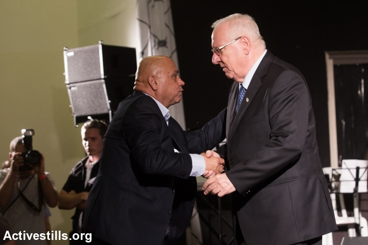 Israeli President Reuven Rivlin greets an Arab-Israeli elder during a memorial ceremony in honor of the Kafr Qassim massacre October 26, 2014, held in the Arab-Israeli town Kfar Qassem. (photo: Yotam Ronen/Activestills.org)