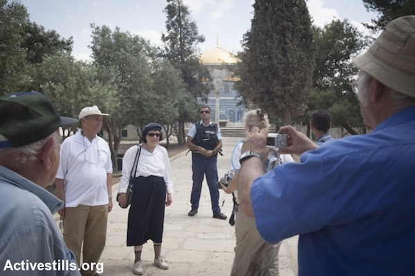 With a police escort, right-wing Jews visit the Aqsa Mosque compound in Jerusalem's Old City at the end of a 'Jerusalem Day' demonstration calling to rebuild the Jewish temple, May 21, 2009. (Photo by Oren Ziv/Activestills.org)