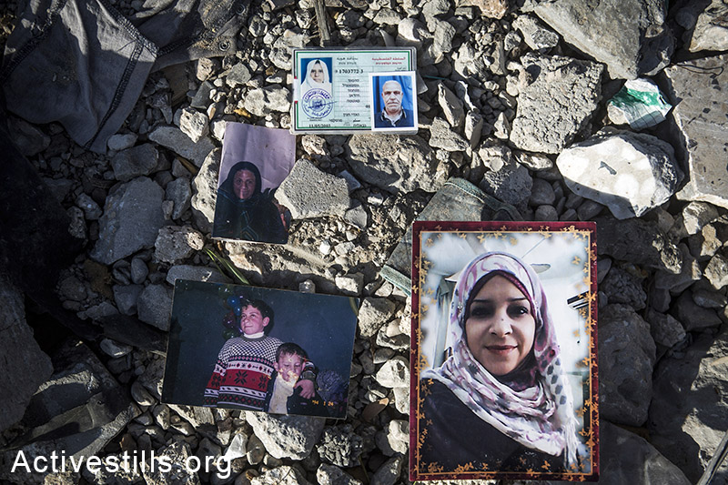 Photos of members of the family of Zaki Wadhan who were killed by Israeli attacks in the city of Beit Hanoun, northern Gaza city, November 10, 2014. Anne Paq/Activestills.org