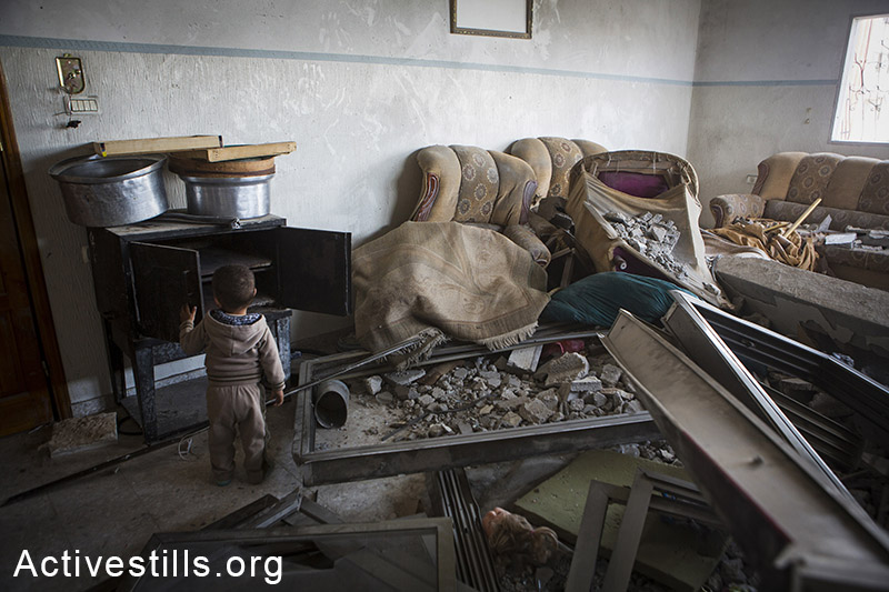 A destroyed living home in the home of al Talal Al Helu in Shujayea neighborood, eastern Gaza city, November 10, 2014. Talal Al Helu lost 11 members of his family, in an attack on his brothers' home.  Anne Paq/Activestills.org