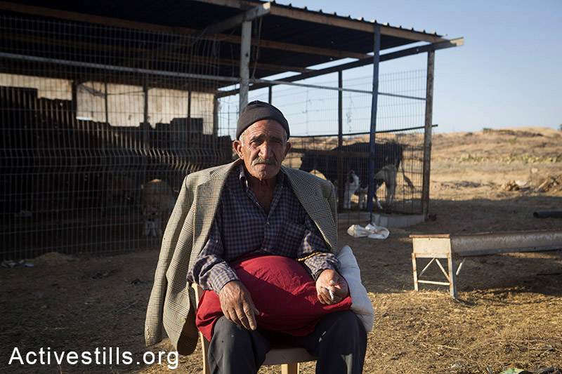 Jaber Abu Sa'eed, a 70-years old Nakba survivor, sits on his land, in the village of Juhor ad-Dik, eastern Gaza Strip, November 6, 2014. His home, located just 300 meters from the border, was demolished by the Israeli army during this summer. Many Palestinians in the Gaza Strip face hard living conditions following the seven-week Israeli offensive during which 2,131 Palestinians were killed, and an estimate of 18,000 housing units have been either destroyed or severely damaged, leaving more than 108,000 people homeless. A woman from Abu Sa'eed family stands in the kitchen of her new tin home, in the village of Juhor ad-Dik, eastern Gaza Strip, November 6, 2014. Their home, located just 300 meters from the border, was demolished by the Israeli army during Operation Protective Edges military offensive on Gaza. Many Palestinians in the Gaza Strip face hard living conditions following the seven-week Israeli offensive during which 2,131 Palestinians were killed, and an estimate of 18,000 housing units have been either destroyed or severely damaged, leaving more than 108,000 people homeless. A child coming out of his destroyed home in the village of Khuza'a, eastern Gaza Strip, November 7, 2014. Six family members stay in the living room, which is the only room which was not destroyed. Big holes in the walls have been barely covered by pieces of wood and plastic sheet. Many Palestinians in the Gaza Strip face hard living conditions following the seven-week Israeli offensive during which 2,131 Palestinians were killed, and an estimate of 18,000 housing units have been either destroyed or severely damaged, leaving more than 108,000 people homeless.  Anne Paq/Activestills.org