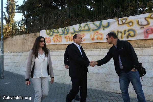 Jerusalem Mayor Nir Barkat (center) arrives at the bilingual school in Jerusalem the morning after it was the target of an arson attack, November 30, 2014. (Photo by Activestills.org)