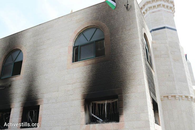 A mosque damaged in a suspected arson hate crime in the West Bank village of Al Mughayir, November 12, 2014. (Photo by Oren Ziv/Activestills.org)