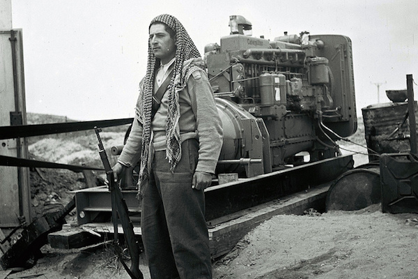 A Druze soldier in the IDF guards a mobile power station, May 13, 1949. (Photo by GPO/Zultan Kluger)