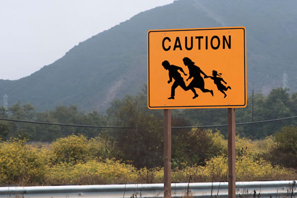 Sign warning of immigrants near the U.S.-Mexican Border. (Photo by Shutterstock.com)