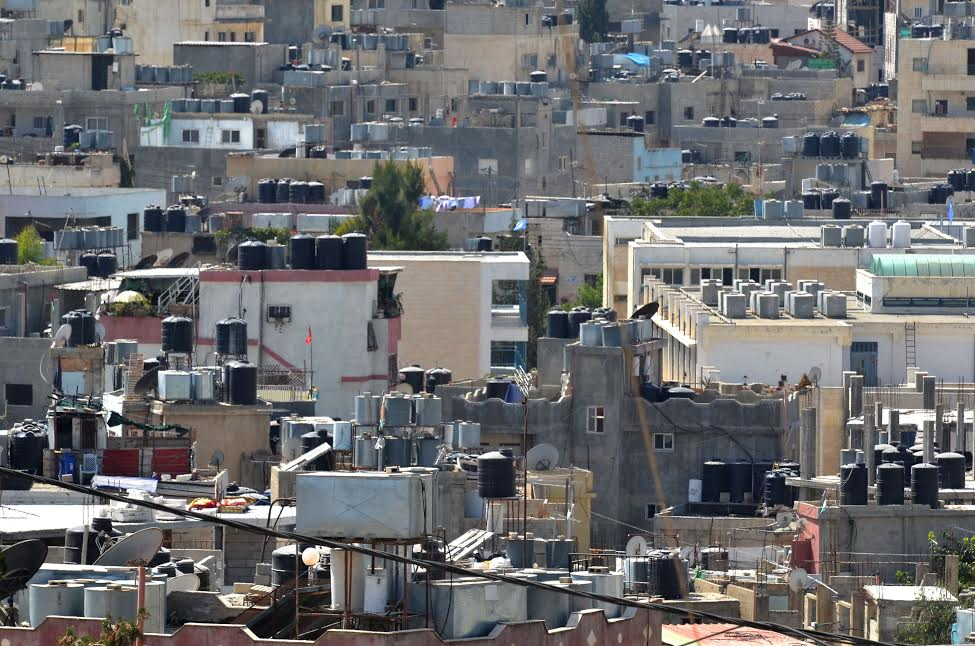 Rooftops jam-packed with water tanks in the Aida  refugee camp near Bethlehem. (photo: Cinzia Di Napoli)
