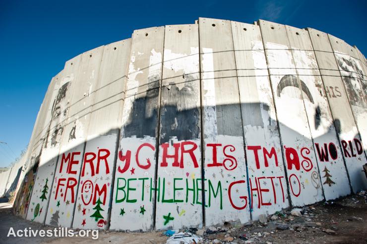 Graffiti on the Israeli separation wall in the West Bank town of Bethlehem, December 16, 2010. (photo: Ryan Rodrick Beiler/Activestills.org)